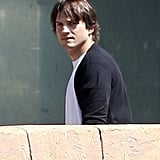 Ashton Kutcher walked into a movie theater in LA with Mila Kunis following behind.