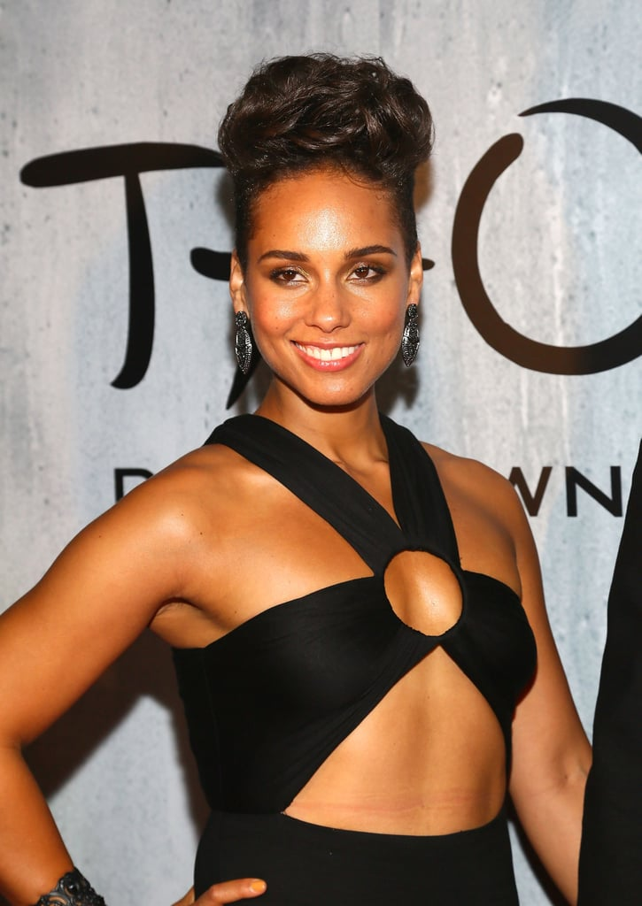 Alicia Keys pulled her hair into a voluminous pompadour, and she opted for a radiant makeup look to go with her revealing top.