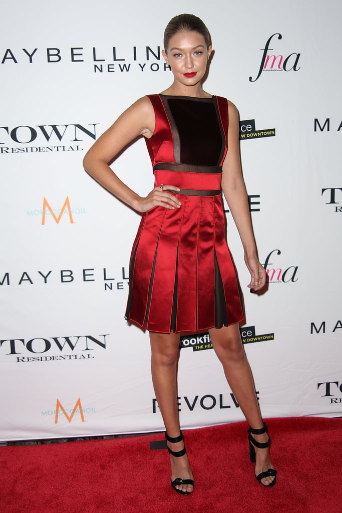 Gigi walked the red carpet at The Daily Front Row's Fashion Media Awards in a cherry-red panelled mini dress by Tommy Hilfiger and black ankle-strap pumps.