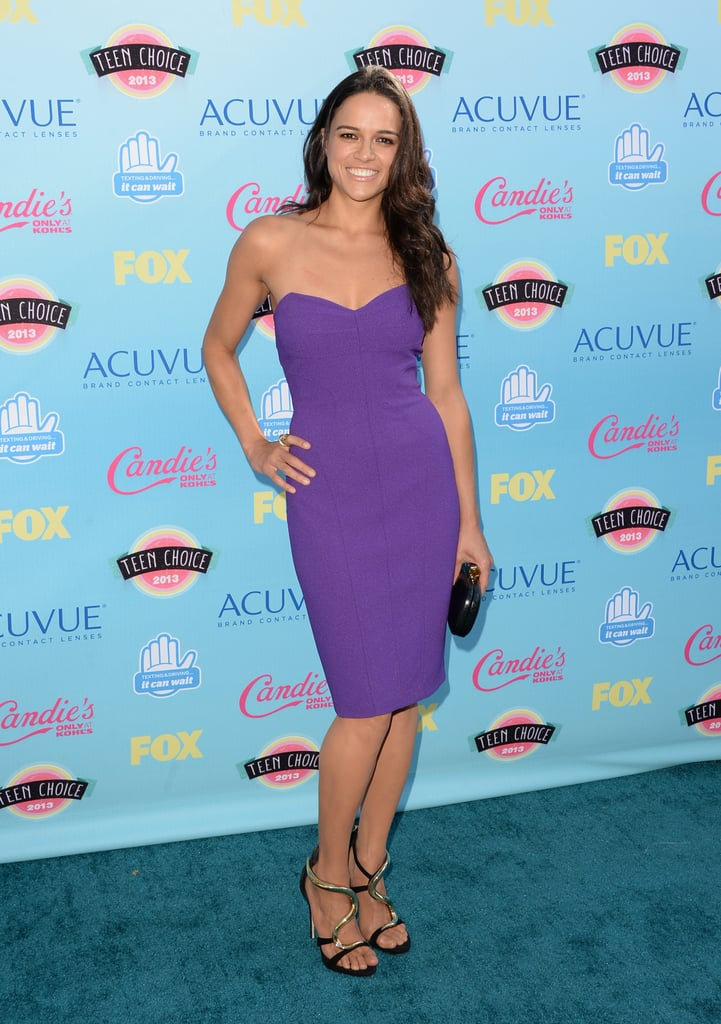 Michelle Rodriguez was at her brightest in a purple David Meister cocktail dress that she styled with Le Vian jewels.
