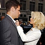 Jessica Simpson helped tidy up Nick Lachey's suit as they arrived at the show in 2003.