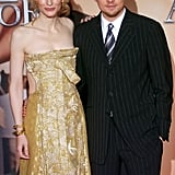At the 2005 premiere of The Aviator in Rome, Leo posed in pinstripes with a gold-clad Cate Blanchett.