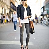 Channel the transition with skinny denim and a cropped jacket, then juxtapose them with chunky platforms and unique shades. Source: Adam Katz Sinding
