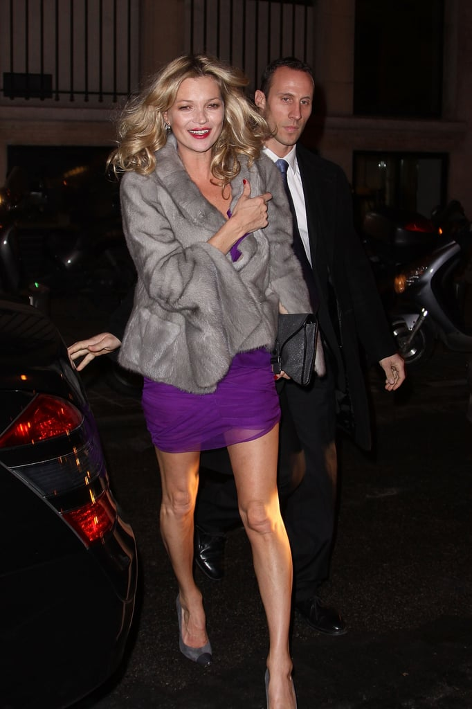 Kate Moss was all smiles in Paris last night as she stepped out in a gorgeous purple dress and grey jacket. Jamie Hince reportedly proposed to her on Tuesday, and she's been wearing a big sparkler on her engagement finger during her trip. She was in high spirits last night, and with a reported wedding date of July 2 set, the couple have a lot to organise — though they've not confirmed the news with a statement. Kate's also scored not one but two covers of the latest issue of Love magazine, one solo and one alongside transgender model Lea T.  Bella UK wants to know which Parisian makeup style you like best on Kate?