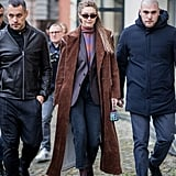 Gigi layered up in a brown corduroy split shoulder coat by Christian Dada.