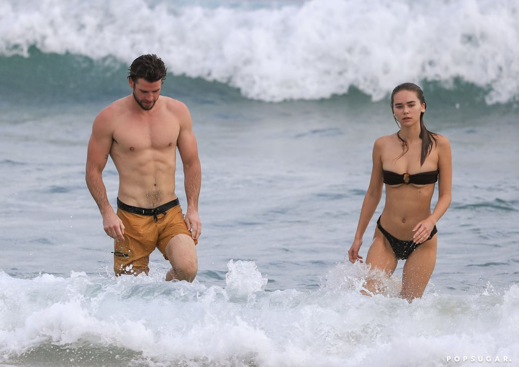 Liam Hemsworth and Gabriella Brooks are still going strong! On Monday, the couple steamed up the beach when they went for a morning swim in Byron Bay, Australia. The 30-year-old actor showed off his ripped abs (seriously, you could grate cheese on those!) in orange swim trunks, while the 23-year-old model slipped into a sexy strapless bikini. Liam and Gabriella seemed to be in good spirits as they splashed around in the water and enjoyed some quality time together.  The pair first sparked dating rumors this past December following Liam's split from Miley Cyrus. Since then, the two have been spotted on a series of dates in both LA and their native Australia, and Gabriella even seems pretty tight with Liam's family. It sounds like things are getting pretty serious! See more of Liam and Gabriella's beach day ahead.       Related:                                                                                                           Liam Hemsworth and Gabriella Brooks's Relationship Timeline Is Mysterious but Adorable