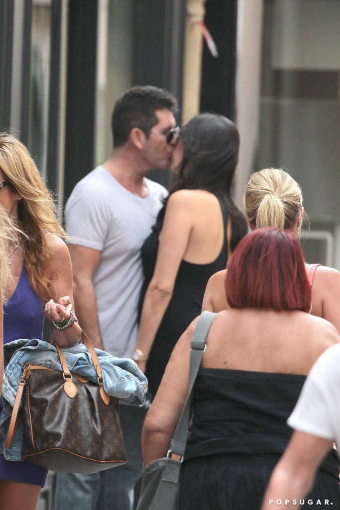 Simon Cowell kissed Lauren Silverman in St.-Tropez.