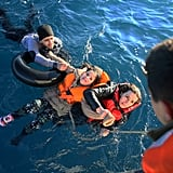 January 22: The Turkish coast guard rescues refugees in Turkey's Aydin, after their dinghy toppled over en route to Greece.