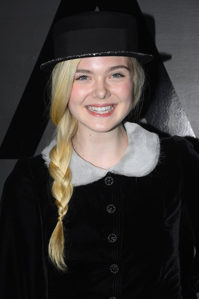 Elle Fanning chose a black hat to finish her look.