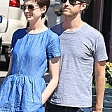 Anne Hathaway wore a blue denim dress and Adam Shulman a gray t-shirt for their shopping date in LA.
