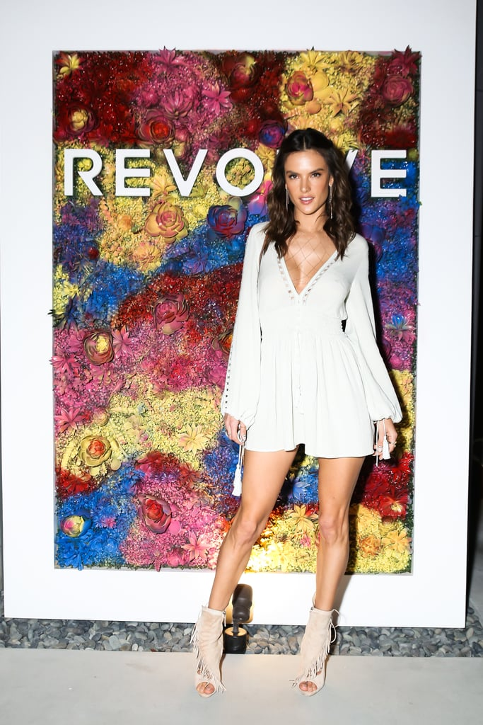 Alessandra Ambrosio wore her own alé by Alessandra Eduarda mini dress to host the Revolve dinner, styled with Giuseppe Zanotti booties.