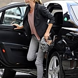 Kate Moss wore gray jeans.