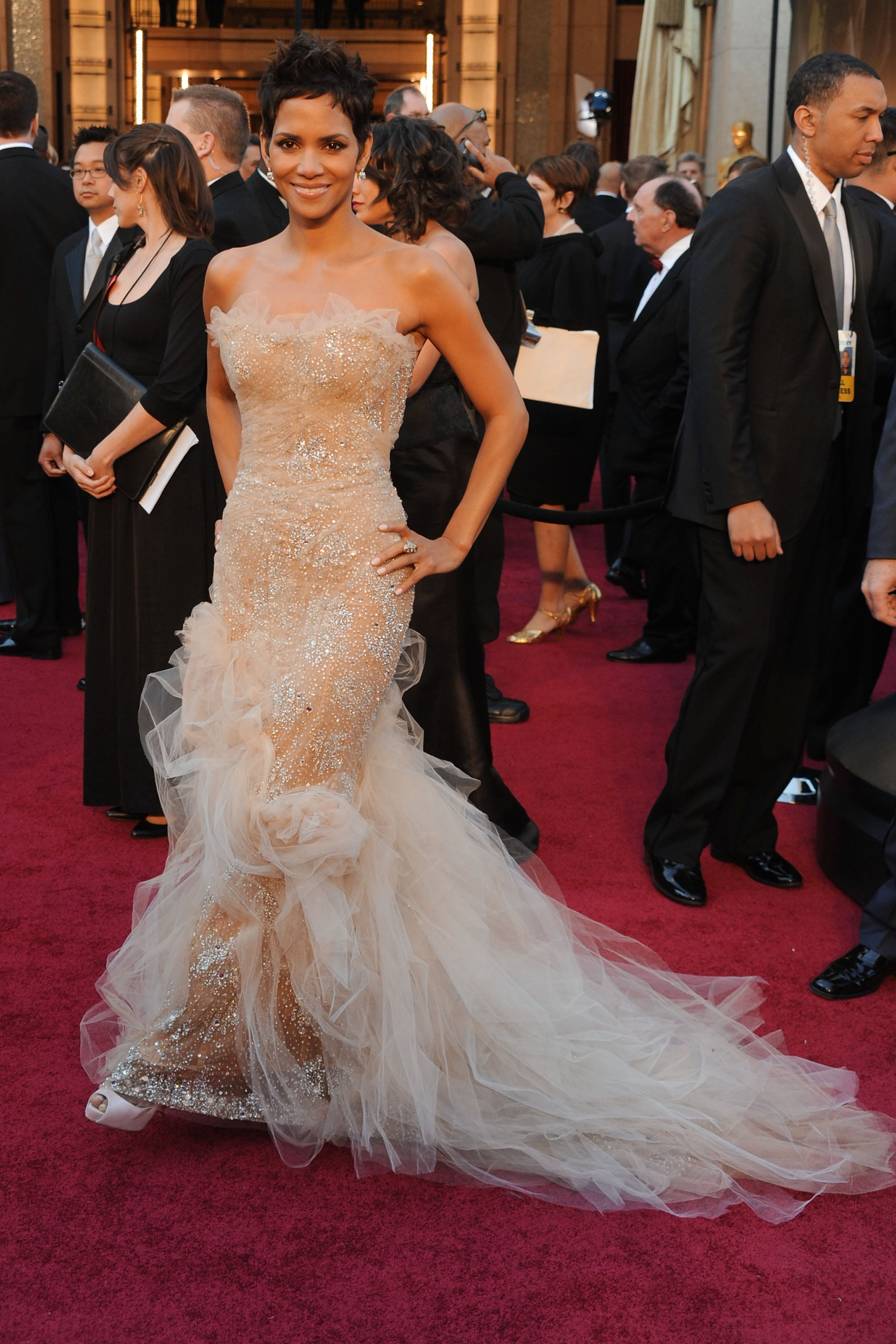 She can still indulge her girlier side in the most glamorous way possible — as evidenced by this nude Marchesa confection at the 2011 Oscars.