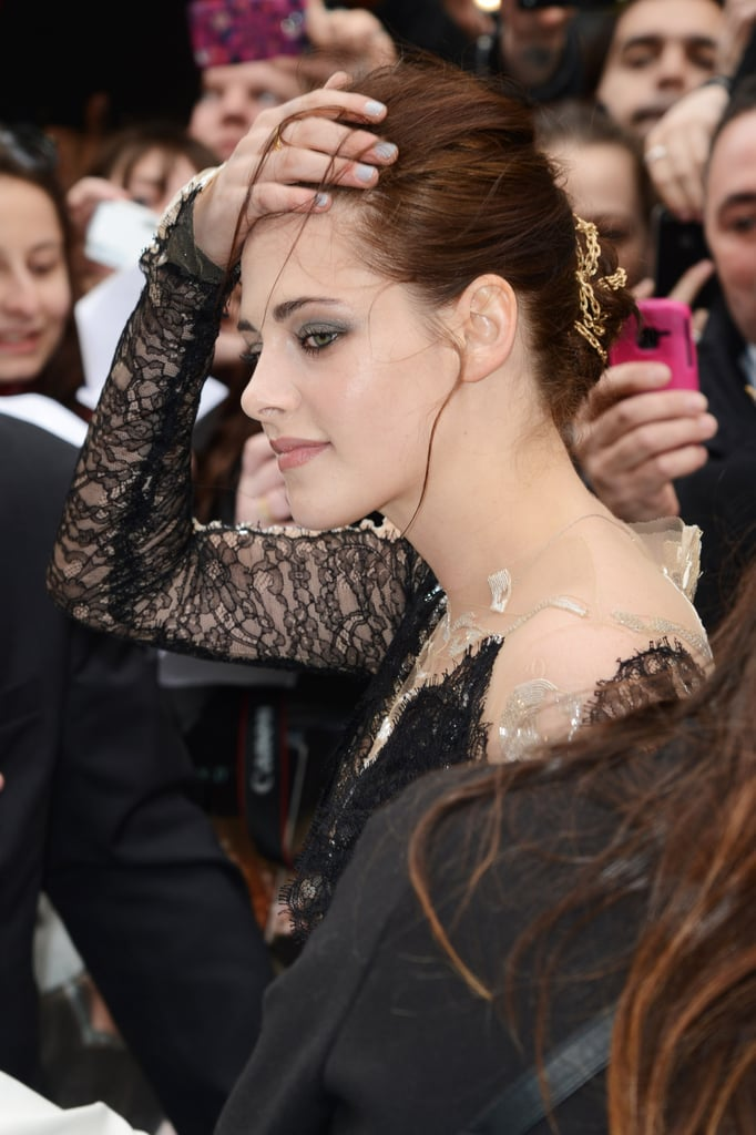 Her up-do showcased her smoky eye makeup — we also get a look at the gold rope strung through her hair.