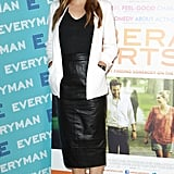 Elizabeth Olsen outfitted a classic black and white palette with a touch of the trends via a white Topshop blazer and ASOS leather pencil skirt.