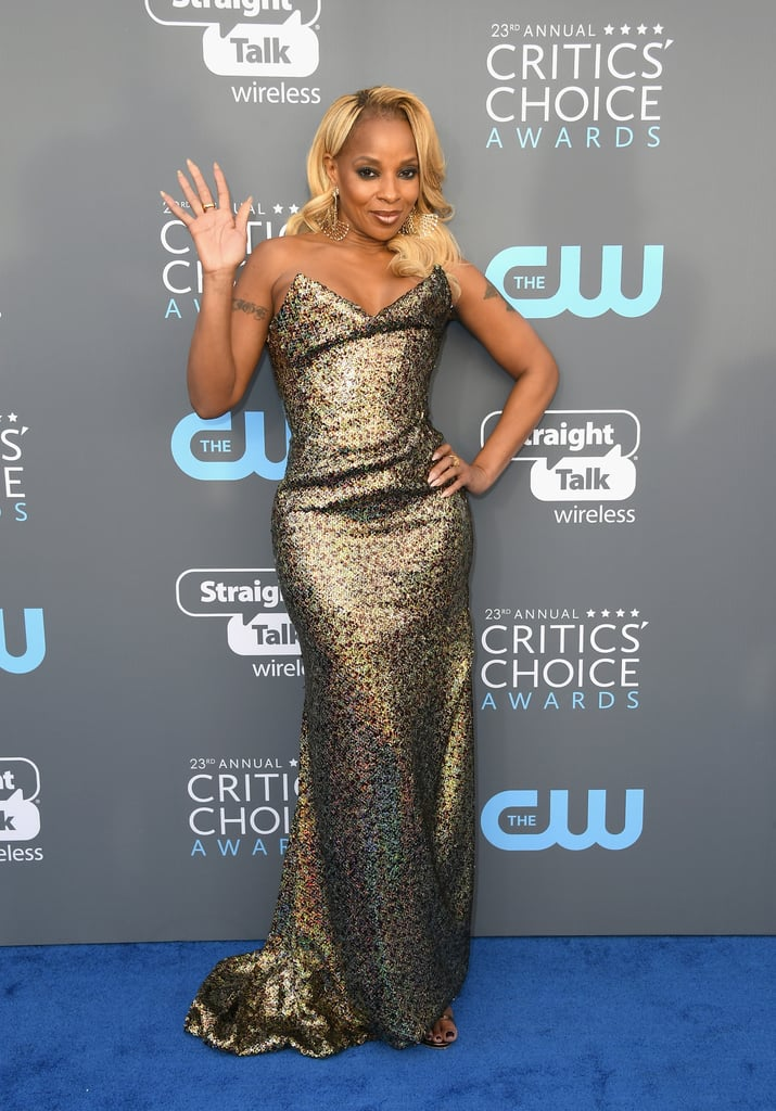 Mary J. Blige hit the red carpet at the Critics' Choice Awards on Thursday just hours after being honored with a star on the Hollywood Walk of Fame. The singer and Mudbound star, who is nominated for best supporting actress, glittered in a gold gown as she posed for photos before heading inside. Earlier in the day, Mary was celebrated for her decades-long career at a Walk of Fame ceremony that brought out her longtime mentor Diddy, as well as Mudbound director Dee Rees and costar Garrett Hedlund — and here's the best part: Thursday also marked her 47th birthday! Mary was even presented with a cake by her family and friends during the event. Talk about a big day! Keep reading to see photos from Mary's festivities.