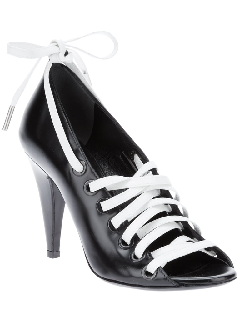 We love the stark black-and-white contrast of Balenciaga's decidedly sporty slant ($675) on the lace-up pump.