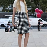 A houndstooth pencil skirt distinguished this look with ladylike details.