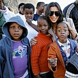 Kim Kardashian posed with local children during a visit to the Motswedi Rehabilitation Centre in Botswana in July 2009.