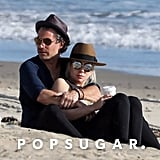Lady Gaga and fiancé Christian Carino cuddled on the beach in March 2018.
