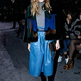 Olivia kept the same jacket on, but ditched the leather pants for a blue leather skirt at the Nina Ricci show.