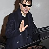 Tom Cruise went out with a smile during a break from filming Mission: Impossible 5 in London on Wednesday.