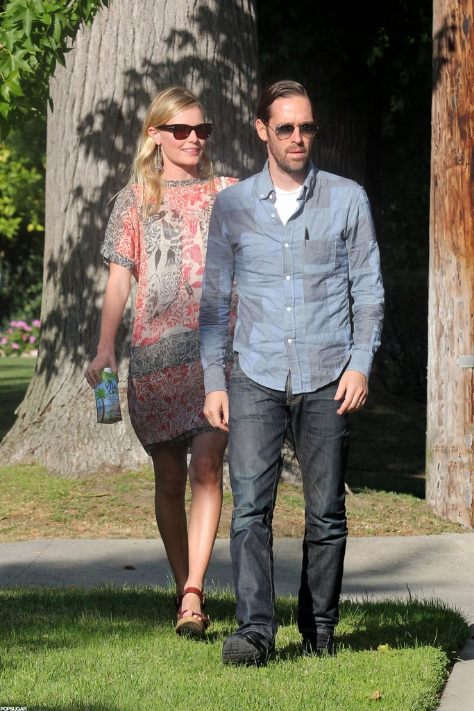 Kate Bosworth and Michael Polish visited with friends during a sunny afternoon in LA yesterday. She was armed for the outing with a Vita Coco, and earlier in the day, was out running errands around town. Kate Bosworth wore an Isabel Marant dress, paired with a JewelMint purse. Kate and Michael are on the West Coast together after spending last week in NYC. In the Big Apple, Kate attended the CFDA Awards with Michael and a special art party for the Whitney Museum. Now that they're home in LA, it's back to business. Kate had a meeting with her JewelMint partner, Cher Coulter, to discuss their new designs as well as their just-launched Boutique accessories collection. She also swung by an acting class with Michael, later lavishing praise on her fellow students on Twitter.