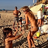 Bar Refaeli got into a water fight with a pint-size pal on the beach. Source: Instagram user barrefaeli
