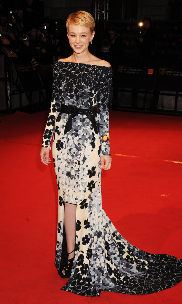 Carey dazzled in a gradient floral gown by Vionnet at the 2010 BAFTAs. The gorgeous creation featured long sleeves, a geometric front hem, mini train, and cinched black sash.