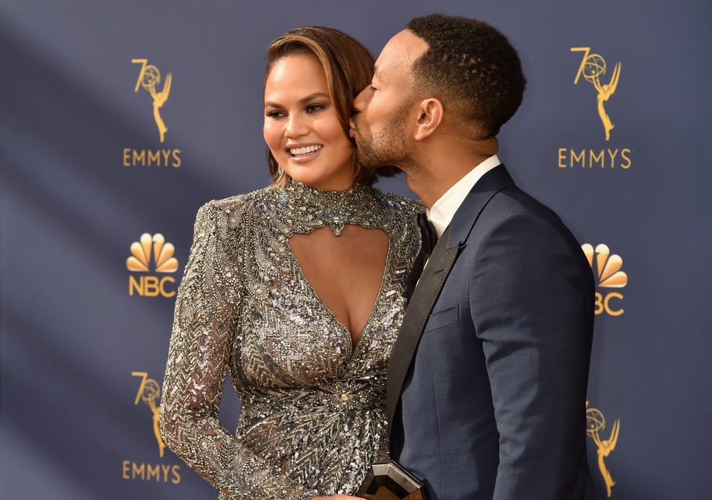 "John Legend and Chrissy Teigen turned the Emmys into their own personal date night on Monday. The couple and parents of two were all smiles as they hit the red carpet. The ""All of Me"" singer looked dapper in a blue suit, while Chrissy looked absolutely stunning in a silver dress. The two even swapped a few sweet kisses in between posing for the cameras.  While John is up for outstanding lead actor in a limited series or movie for his starring role in Jesus Christ Superstar Live in Concert, he has already won big this season. During the Creative Arts Emmy Awards on Sept. 9, he officially achieved EGOT status when he took outstanding variety special for Jesus Christ Superstar Live, which he co-produced. Not only was the award a ground-breaking moment in his career, but he also made history as the first black male to accomplish EGOT glory. Naturally, Chrissy couldn't help but brag on her husband with a sweet post on social media.  Something tells us John and Chrissy are in for another fun-filled night at the Emmys! See their best moments from the show ahead.       Related:                                                                                                           Chrissy Teigen and John Legend Bring New Meaning to the Term ""Relationship Goals"""