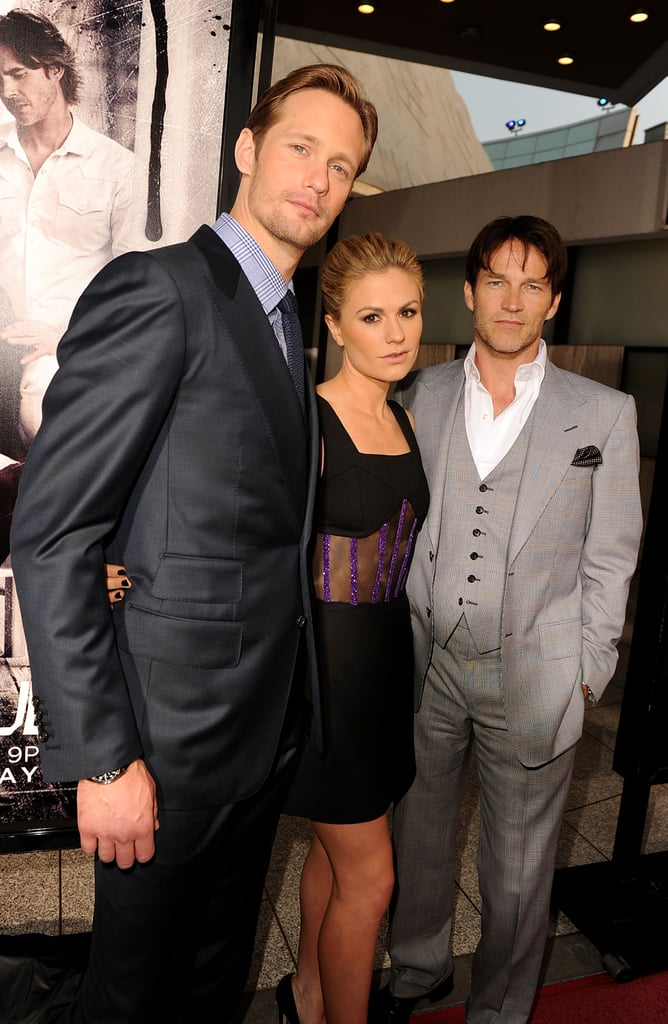 Anna Paquin and Stephen Moyer were arm in arm at the premiere of True Blood last night in Hollywood, joining their costar Alexander Skarsgard for the big debut. The onscreen vampires may be part of a love triangle on the HBO hit, but off screen, the trio are close friends. Stephen recently said he thinks the romance heating up between Anna's Sookie and Alexander's Eric will be a good thing for the series, but he personally chooses not to watch his wife tape love scenes with Alex. Stephen is on the cover of Men's Health's new issue, in which he opened up about falling in love with Anna during the show's first months by sometimes Skyping for two or three hours a night! Alexander, Anna, and Stephen's many costars were also on hand to toast the program and its success. Werewolf Joe Manganiello looked rugged in red, and Ryan Kwanten, Nelsan Ellis, and Todd Lowe rounded out the cute guys on the carpet. Meanwhile, Evan Rachel Wood debuted a bold, cropped hairstyle, Deborah Ann Woll looked lovely in a lace gown by Tadashi Shoji, and Rutina Wesley glowed in a simple, beaded dress. The countdown is on for fans of the drama — True Blood season four debuts on this Sunday, June 26!