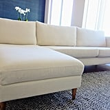 To achieve this look, I spent about two hours with my husband swapping out the covers and legs. I had to unscrew the pieces of the couch and then put it all back together once I was done. It takes similar elbow grease as your typical Ikea assembly, but just make sure you're prepared. The project gave me a chance to bring new life to my sofa. Even just moving around and fluffing up the cushions as I changed the covers made it feel fresh. The overall finished product is luxurious. I especially love how soft the new fabric is. Instead of splurging $11,000 on a new couch, this refresh cost $899 total for the legs and covers (based on prices at the time). Well worth it for a living room makeover!  (Note: Bemz provided the cover samples I chose free of charge.)
