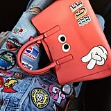 A Bag or Phone Covered in Anya Hindmarch Stickers