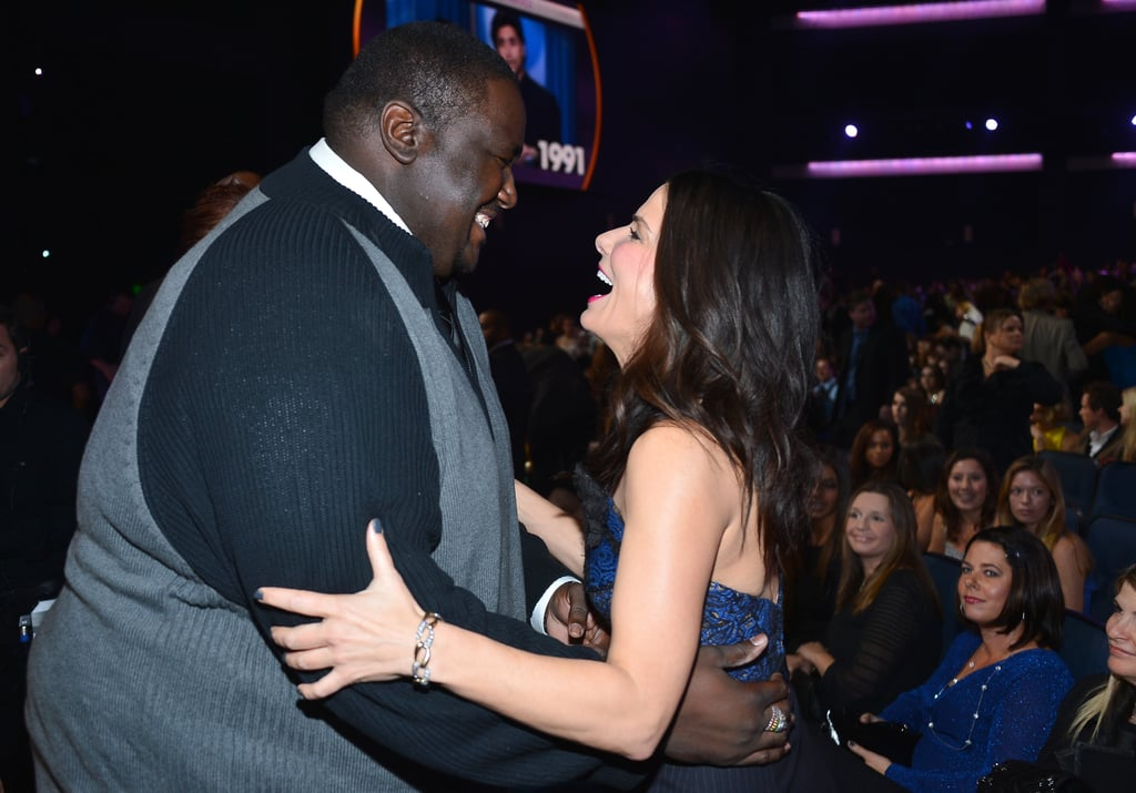 Sandra Bullock shared a laugh with her The Blind Side costar, Quintin Aaron, at the People's Choice Awards in January 2013.