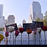 Flowers and pictures lined the 9/11 Memorial in NYC.
