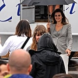 Penelope Cruz made her way onto the set with an umbrella.