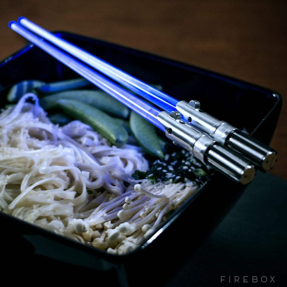 Lightsaber chopsticks exist, Star Wars fans, so prepare to be the MVP next time you meet your friends for a sushi dinner. The light-up chopsticks from Firebox come in a variety of colors, so whether you're into Kylo Ren or you'd rather channel Luke Skywalker, there's a pick that will suit your obsession. Not a huge Star Wars fan? Chances are you know somebody who is, and these chopsticks would make a great stocking stuffer — right on the heels of The Last Jedi's release, no less. Check out more pictures of the lightsaber chopsticks, then dive into the all best gift ideas for Star Wars fans.       Related:                                                                                                           21 Star Wars: The Last Jedi Gifts That Will Make You the Best Santa in the Galaxy