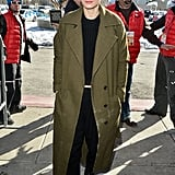 When outdoors, Rooney threw on an olive-green coat for a fashion-forward colour pairing we love.