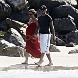 Pregnant Victoria Beckham on the beach with David.