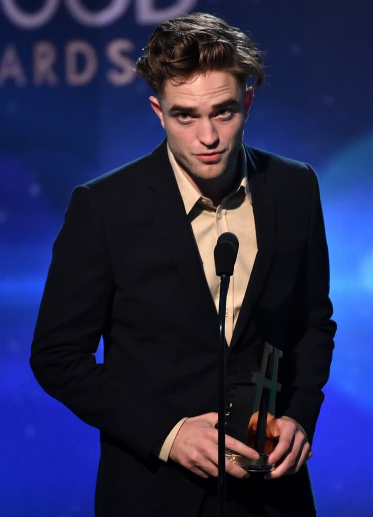 Robert Pattinson popped up on the stage at the Hollywood Film Awards in LA on Friday night, giving us a better look at the hot new hipster haircut he debuted last night at the Go Go Gala. Rob is being honored with a big award during the ceremony tonight, which has also brought out his ex-girlfriend and former Twilight costar, Kristen Stewart. Rob showed up solo despite being spotted out and about with his new love, singer FKA Twigs, earlier this week in NYC; Robert and FKA have been traveling the world together over the past couple of months, popping up in Paris, Brussels, and Toronto, where the actor was working on a new project, Idol's Eye. Keep reading for more photos of Rob's night at the Hollywood Film Awards.