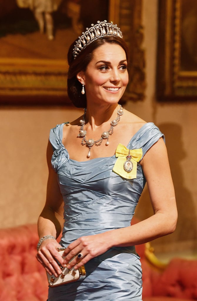 """No rest for the royals! As Prince Harry and Meghan Markle continue their tour of Australia, Kate Middleton and Prince William got all glammed up for a state banquet at Buckingham Palace on Tuesday. Kate channeled Cinderella in a stunning Alexander McQueen gown complete with the Lover's Knot tiara, while William suited up in a black tail tux. The royals were joined by British Prime Minister Theresa May, as well as King Willem-Alexander of the Netherlands and Queen Maxima.  During the reception, Williem-Alexander gushed about Queen Elizabeth II in his speech, calling her the """"most fearless Bond girl,"""" referring to her 2012 London Olympics opener. """"The world looks to you as a trusted beacon in the midst of upheaval,"""" he said. """"Your ability to keep in touch with the times is striking. You even have an adventurous streak, as you showed six years ago at the opening of the Olympic Games. In front of millions of viewers you played the role of the most fearless Bond girl ever — with great panache!"""" Just last week, William hosted a reception for the winners of BBC's Teen Awards at Kensington Palace, where he adorably revealed that Prince George love to dance, just like Princess Diana did. """"George is doing dancing as well, he loves it,"""" William said in a Twitter video posted by Kensington Palace. """"My mother always used to dance, she loved dancing. And if it's something you love, you do what you love. Don't let anyone else tell you otherwise. Keep at it."""" See photos from William and Kate's glamorous night ahead.       Related:                                                                                                           See Meghan and Kate's Royal Tours of Australia and New Zealand, Side by Side"""