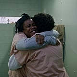 Aw! Suzanne shares a happy hug with a fellow inmate who looks like Cindy.