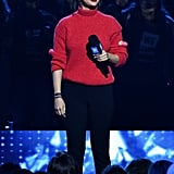 A Red Turtleneck and Black Jeans at WE Day California in April 2018