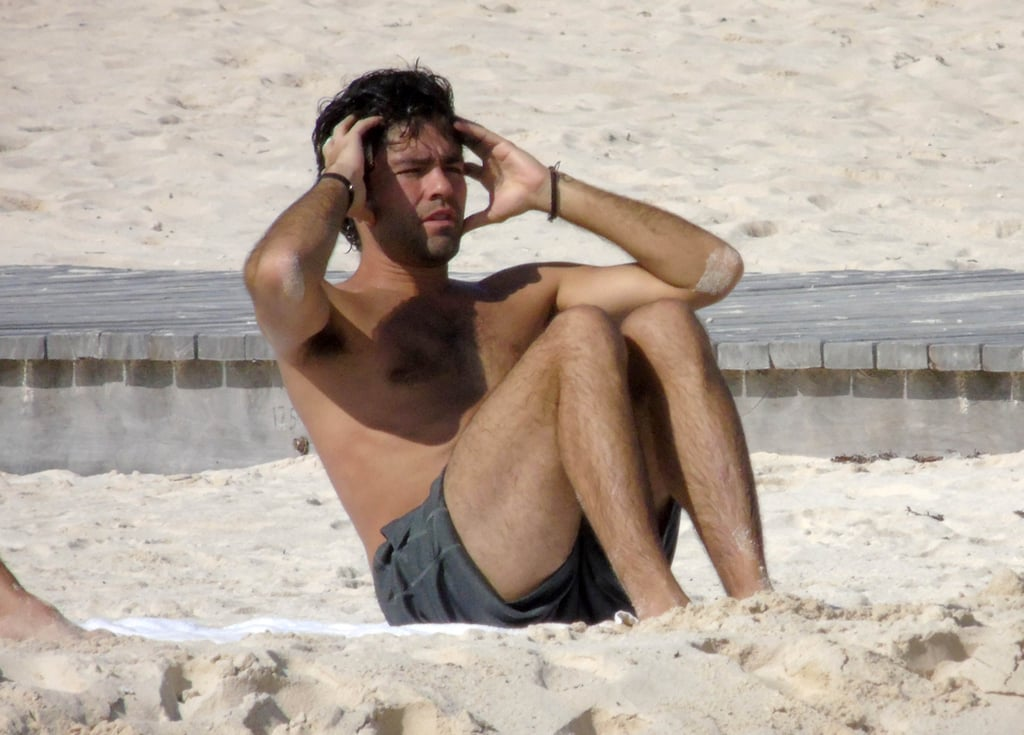 Adrian Grenier got a head start on his holiday vacation on Friday when he hit the beach in Cancun, Mexico, along with a group of friends. The Entourage star was seen taking a dip in the crystal-blue waters before returning to the sand to do a few push-ups and sit-ups alongside a male pal. The two guys later met up with a bikini-clad woman before heading farther down the beach together. This is hardly the first time that Adrian has hit the beach this year — back in May, the actor showed off his shirtless physique during a trip to Cannes. He has been taking it easy since wrapping up production on the highly anticipated Entourage movie, which is slated to premiere on June 5, 2015.