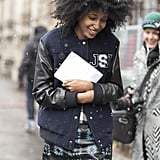 Julia Sarr-Jamois effortlessly mixed up a printed leather skirt and varsity jacket.