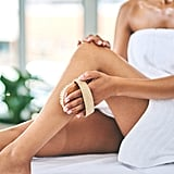"""At-Home Waxing Tip #2: Prep the Skin for Waxing Many of the same rules apply here as they do for professional waxing — exfoliate is key. """"It's important that your skin is clean and free of oils, dirt, and moisturisers,"""" said Ismiel. """"A well-timed scrub has plenty of benefits. It removes dead skin cells that block the hair follicle (the cause of undesirable ingrown hairs). Exfoliating also boosts circulation, encourages cell regeneration, and improves skin tone and appearance."""" At-Home Waxing Tip #3: Treat Ingrown Hairs Before They Appear As for those pesky ingrown hairs. This is an unfortunate side-effect of even the best salon waxes, but you can help minimise your chances of getting ingrown hairs by taking a few precautionary steps. Ismiel recommended applying a hot compress for 15 minutes a few times a day after you remove hair and exfoliating regularly — but only after your skin has healed from the wax."""