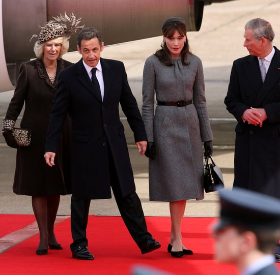 Nicolas Sarkozy and Carla Bruni Arrive in England to Meet the Royal Family