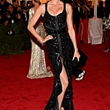 Gisele Bundchen posed in Givenchy on the red carpet at the Met Gala.