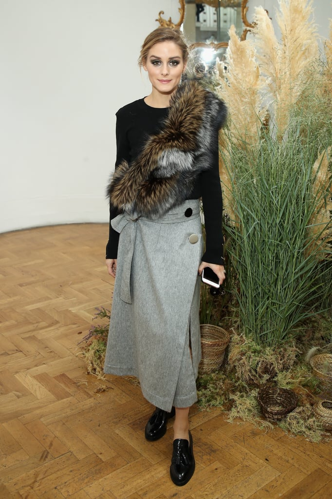 Ever the mix-master, Olivia showed her styling prowess, adding a furry finish to a wrap skirt and crew-neck sweater at London Fashion Week.
