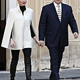 For an official outing with her husband, Prince Albert II of Monaco, Princess Charlene wore a black jumper, black trousers, black over-the-knee boots, and a cream cape coat.